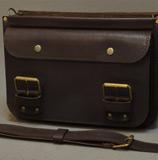 портфель из кожи коньячного цвета