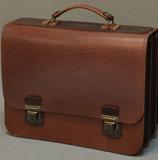 Большой и солидный бордово-коричневый портфель