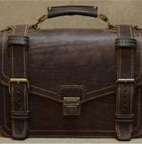 вместительный портфель из толстой кожи