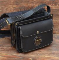 Женская сумочка из черной кожи