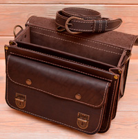 Аккуратная коричневая кожаная сумка